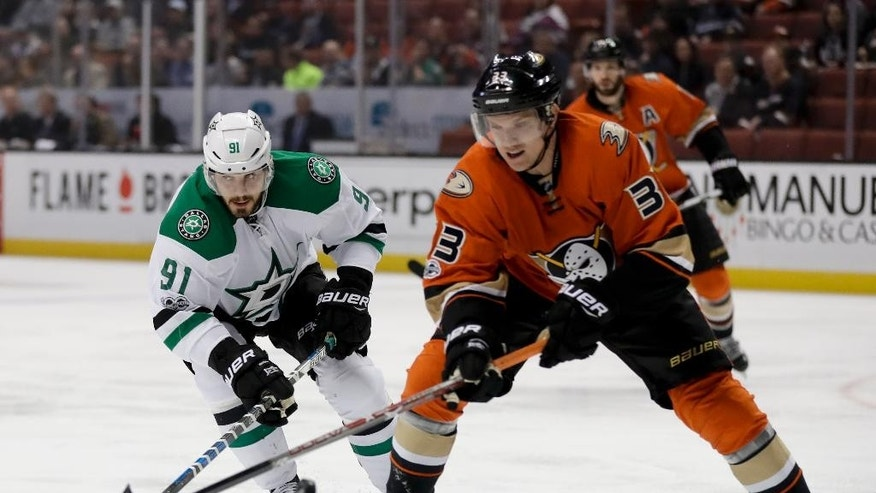 Dallas Stars center Tyler Seguin, left, shoots past Anaheim Ducks right wing Jakob Silfverberg during the first period of an NHL hockey game in Anaheim, Calif., Tuesday, Jan. 10, 2017. (AP Photo/Chris Carlson)