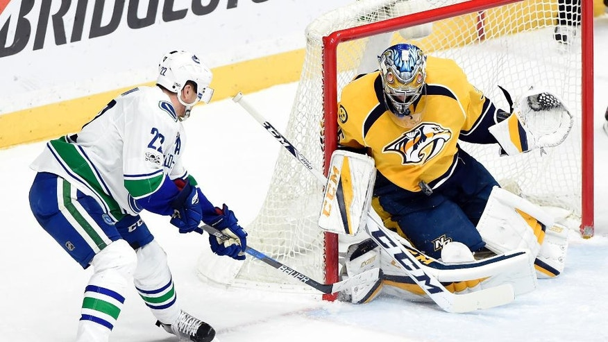 Nashville Predators goalie Pekka Rinne (35), of Finland, blocks a shot by Vancouver Canucks left wing Daniel Sedin (22), of Sweden, during the third period of an NHL hockey game Tuesday, Jan. 10, 2017, in Nashville, Tenn. The Predators won in overtime 2-1. (AP Photo/Mark Zaleski)