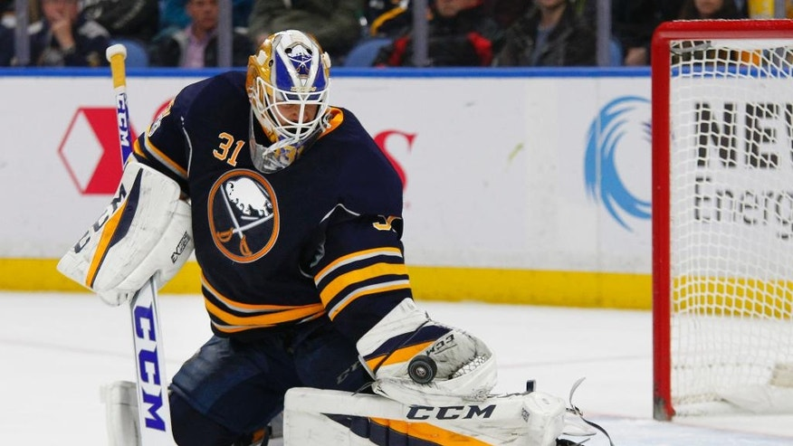 Buffalo Sabres goalie Anders Nilsson makes a glove save during the second period of an NHL hockey game against the Philadelphia Flyers, Tuesday, Jan. 10, 2017, in Buffalo, N.Y. (AP Photo/Jeffrey T. Barnes)
