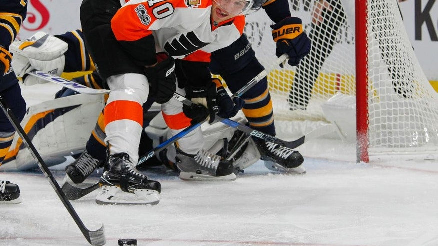 Philadelphia Flyers forward Brayden Schenn (10) looks for the puck during the second period of the team's NHL hockey game against the Buffalo Sabres, Tuesday, Jan. 10, 2017, in Buffalo, N.Y. (AP Photo/Jeffrey T. Barnes)