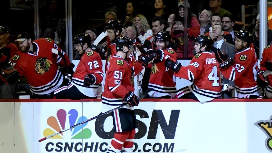 Chicago Blackhawks defenseman Brian Campbell (51) celebrates his goal against the Detroit Red Wings with teammates during the first period of an NHL hockey game Tuesday, Jan. 10, 2017, in Chicago. (AP Photo/Matt Marton)