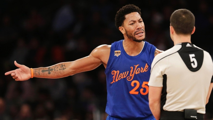 New York Knicks' Derrick Rose argues with a referee during the first half of the NBA basketball game against the Boston Celtics, Sunday, Dec. 25, 2016 in New York.