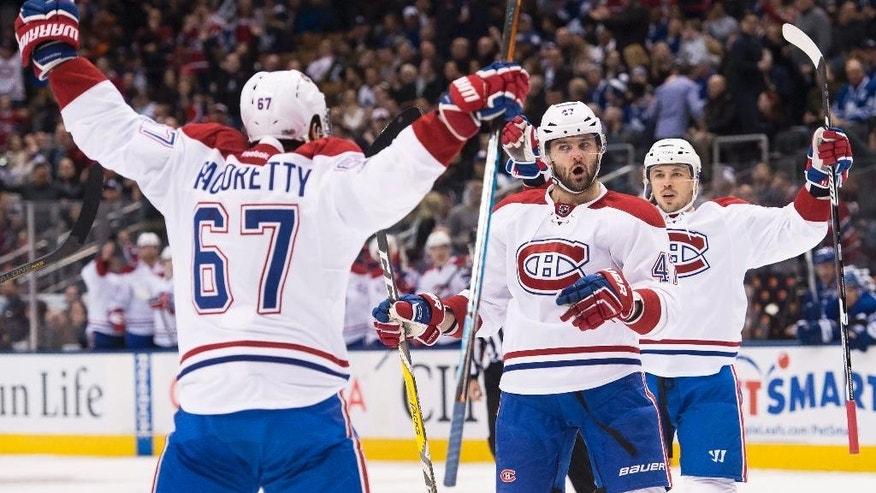 Montreal Canadiens left wing Max Pacioretty (67) celebrates his goal with teammate Alexander Radulov (47) during the first period of an NHL hockey game against the Toronto Maple Leafs, in Toronto on Saturday, Jan. 7, 2017. (Nathan Denette/The Canadian Press via AP)