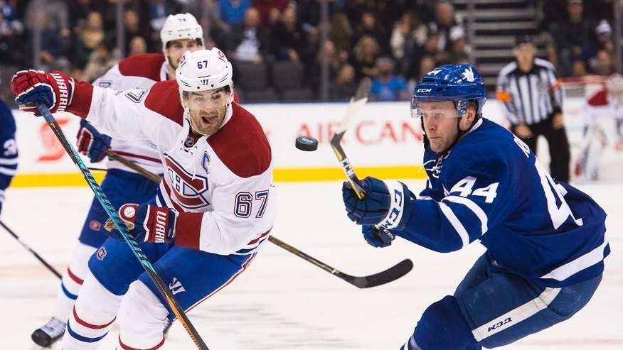 Montreal Canadiens left wing Max Pacioretty (67) vies for the loose puck with Toronto Maple Leafs defenseman Morgan Rielly (44) during the third period of an NHL hockey game in Toronto on Saturday, Jan. 7, 2017.  (Nathan Denette/The Canadian Press via AP)