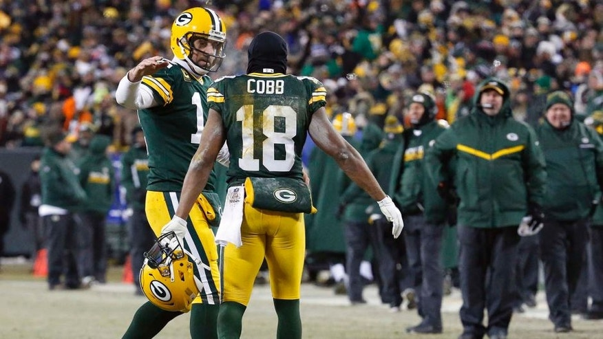 Green Bay Packers quarterback Aaron Rodgers (12) and wide receiver Randall Cobb (18) celebrate after a touchdown during the second half of an NFC wild-card NFL football game against the New York Giants, Sunday, Jan. 8, 2017, in Green Bay, Wis. (AP Photo/Mike Roemer)