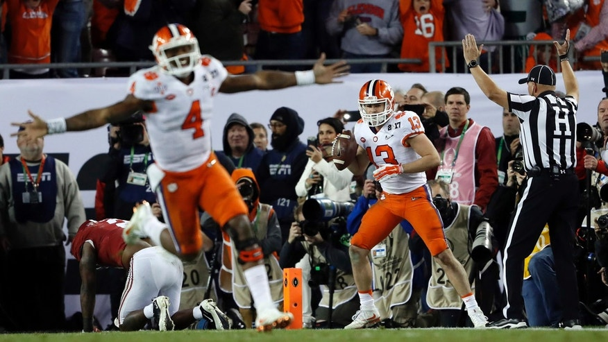 Jan. 10, 2017: Clemson's Deshaun Watson celebrates a last second touchdown pass to Hunter Renfrow (13) to win the NCAA college football playoff championship game against Alabama in Tampa, Fla.