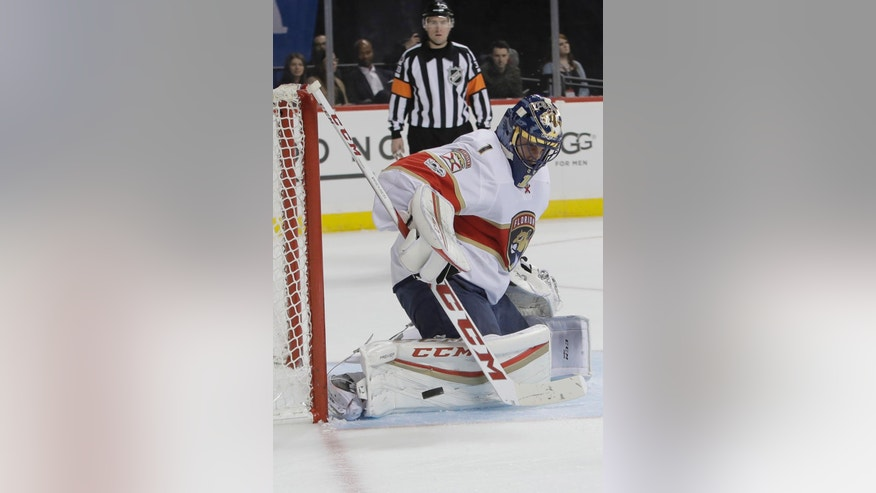 Florida Panthers goalie Roberto Luongo (1) stops a shot during the second period of the team's NHL hockey game against the New York Islanders on Wednesday, Jan. 11, 2017, in New York. (AP Photo/Frank Franklin II)