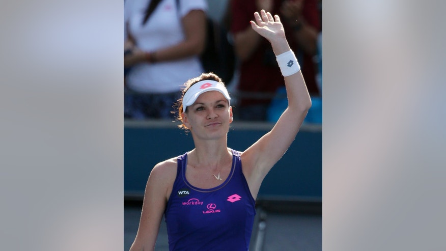 Agnieszka Radwanska of Poland waves after her win over Barbora Strycova of Czech Republic during their women's semifinal singles match at the Sydney International tennis tournament in Sydney Thursday, Jan. 12, 2017. (AP Photo/Rick Rycroft)