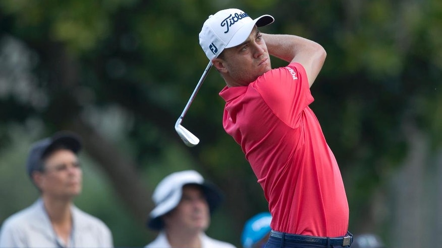 Justin Thomas follows his drive off the 11th tee during the first round of the Sony Open golf tournament, Thursday, Jan. 12, 2017, in Honolulu. (AP Photo/Marco Garcia)