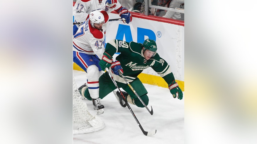 Minnesota Wild's Ryan Suter, right, is tripped up by Montreal Canadiens' Alexander Radulov of Russia during the second period of an NHL hockey game Thursday, Jan. 12, 2017, in St. Paul, Minn. (AP Photo/Jim Mone)