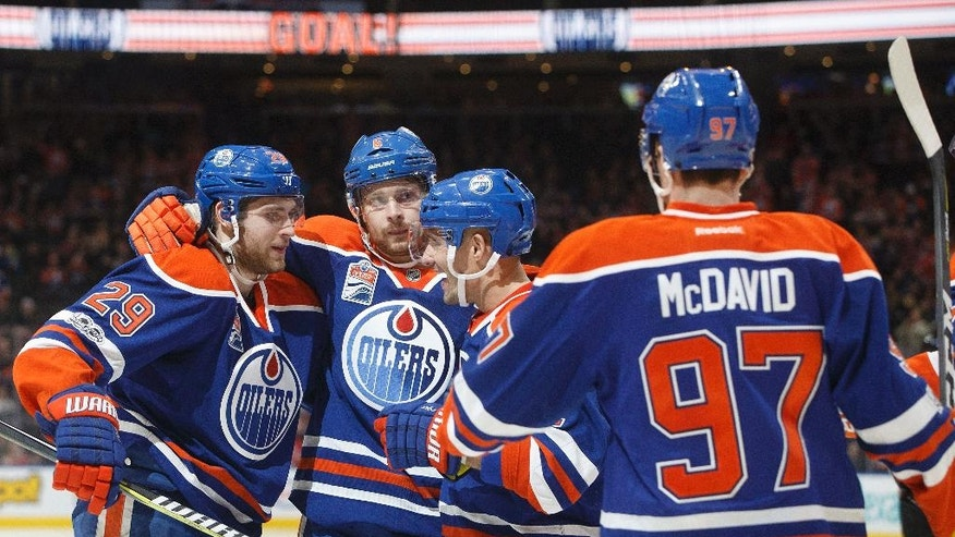 Edmonton Oilers' Leon Draisaitl (29), Adam Larsson (6) Andrej Sekera (2) and Connor McDavid (97) celebrate a goal against the New Jersey Devils during the second period of an NHL hockey game, Thursday, Jan. 12, 2017 in Edmonton, Alberta. (Jason Franson/The Canadian Press via AP)