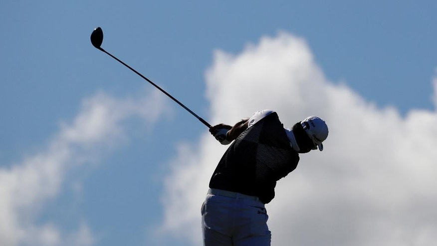 Hideki Matsuyama, of Japan, hits from the fifth tee during the final round of the Tournament of Champions golf event, Sunday, Jan. 8, 2017, at Kapalua Plantation Course in Kapalua, Hawaii. (AP Photo/Matt York)