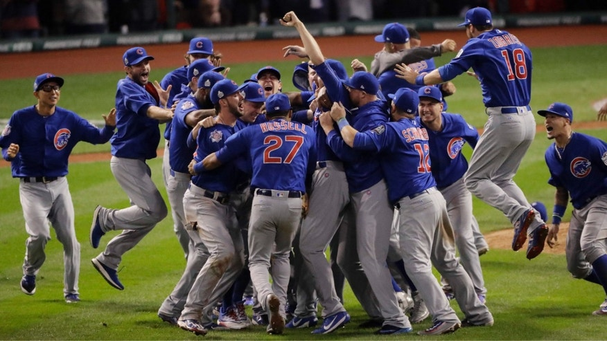 FILE - In this Nov. 3, 2016, file photo, the Chicago Cubs celebrate after Game 7 of the Major League Baseball World Series against the Cleveland Indians, in Cleveland.