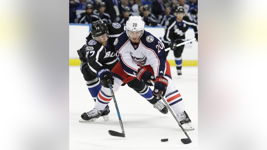 Columbus Blue Jackets left wing Brandon Saad (20) gets around Tampa Bay Lightning defenseman Victor Hedman (77), of Sweden, during the first period of an NHL hockey game Friday, Jan. 13, 2017, in Tampa, Fla. (AP Photo/Chris O'Meara)