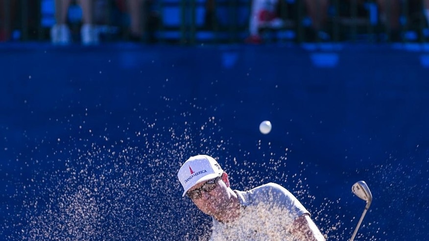 Zach Johnson hits out of a greenside bunker on 18th for an eagle during the second round of the Sony Open golf tournament, Thursday, Jan. 12, 2017, in Honolulu. (AP Photo/Marco Garcia)