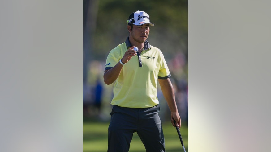 Hideki Matsuyama, of Japan, waves to the gallery on the third green during the second round of the Sony Open golf tournament, Thursday, Jan. 12, 2017, in Honolulu. (AP Photo/Marco Garcia)