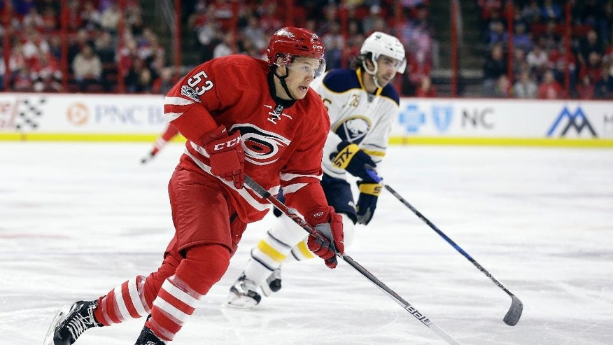 Carolina Hurricanes' Jeff Skinner (53) lines up for a shot as Buffalo Sabres' Matt Moulson chases during the second period of an NHL hockey game in Raleigh, N.C., Friday, Jan. 13, 2017. Skinner scored on the play. (AP Photo/Gerry Broome)