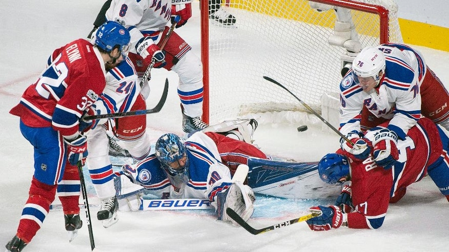 Montreal Canadiens' Brian Flynn (32) scores against New York Rangers goaltender Henrik Lundqvist as Canadiens' Alexander Radulov (47) and Rangers' Brady Skjei (76) look for the rebound during second-period NHL hockey game action in Montreal, Saturday, Jan. 14, 2017. (Graham Hughes/The Canadian Press via AP)