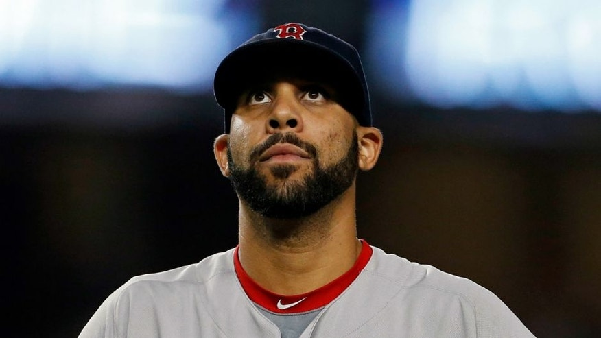 Sep 27, 2016; Bronx, NY, USA; Boston Red Sox starting pitcher David Price (24) reacts after giving up a two-run home run to New York Yankees first baseman Tyler Austin (26) during the seventh inning at Yankee Stadium. Mandatory Credit: Adam Hunger-USA TODAY Sports