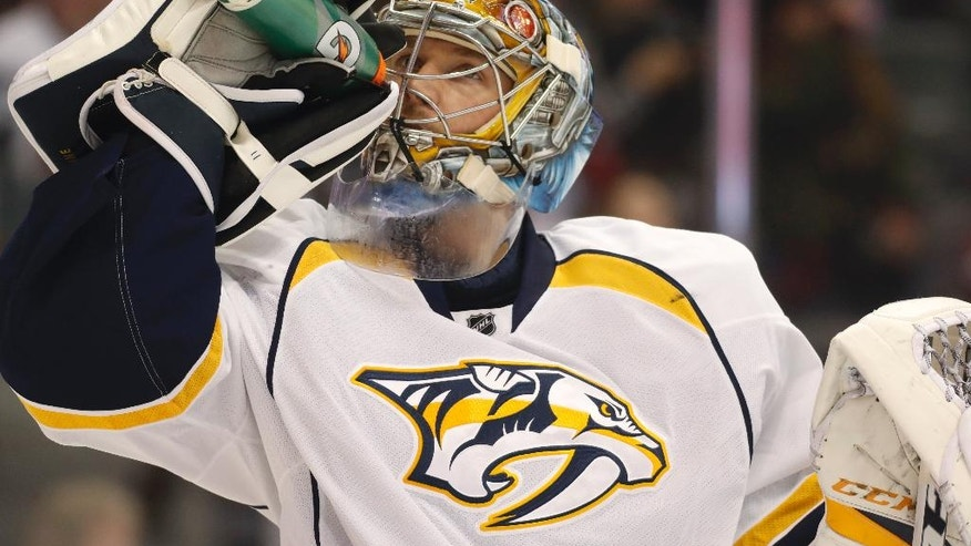 Nashville Predators goalie Pekka Rinne, of Finland, reacts after giving up a goal to Colorado Avalanche left wing Gabriel Landeskog in the first period of an NHL hockey game, Saturday, Jan. 14, 2017, in Denver. (AP Photo/David Zalubowski)