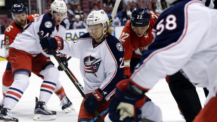 Columbus Blue Jackets center William Karlsson (25) and Florida Panthers left wing Shawn Thornton (22) fight for the puck during the first period of an NHL hockey game, Saturday, Jan. 14, 2017, in Sunrise, Fla. (AP Photo/Lynne Sladky)
