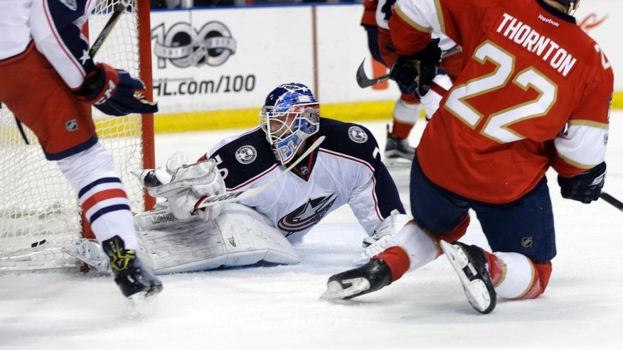 Florida Panthers left wing Shawn Thornton (22) scores a goal past Columbus Blue Jackets goalkeeper Joonas Korpisalo, left, during the first period of an NHL hockey game, Saturday, Jan. 14, 2017, in Sunrise, Fla. (AP Photo/Lynne Sladky)