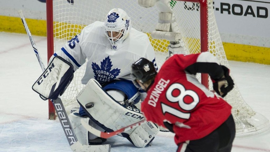Ottawa Senators left wing Ryan Dzingel fires the puck at Toronto Maple Leafs goalie Curtis McElhinney during the second period of an NHL hockey game Saturday, Jan. 14, 2017, in Ottawa, Ontario. (Adrian Wyld/The Canadian Press via AP)