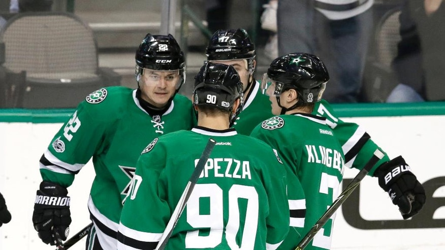 Dallas Stars' Jason Spezza (90), John Klingberg (3), of Sweden, and Devin Shore (17) celebrate with Jiri Hudler (22), of the Czech Republic, after Hudler scored a goal against the Minnesota Wild in the second period of an NHL hockey game in Dallas, Saturday Jan. 14, 2017. (AP Photo/LM Otero)
