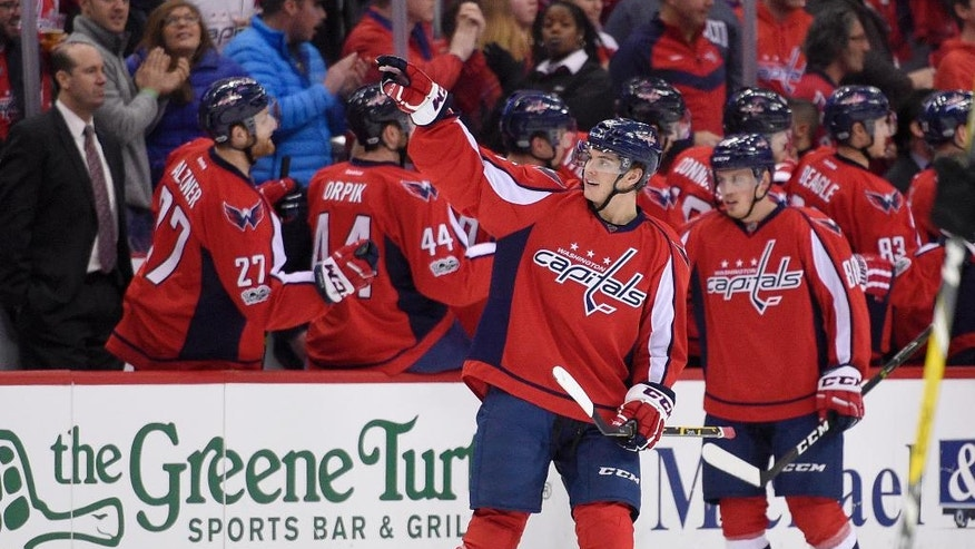 Washington Capitals left wing Andre Burakovsky (65), of Austria, (65) gestures as he celebrates his goal during the second period of an NHL hockey game against the Philadelphia Flyers, Sunday, Jan. 15, 2017, in Washington. (AP Photo/Nick Wass)