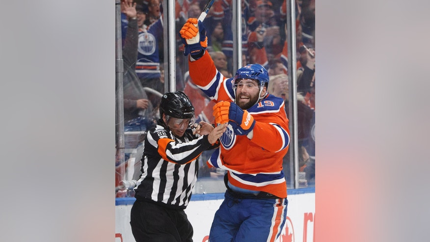Edmonton Oilers' Patrick Maroon (19) celebrates a goal against the Calgary Flames during the second period of an NHL hockey game Saturday, Jan. 14, 2017, in Edmonton, Alberta. (Jason Franson/The Canadian Press via AP)