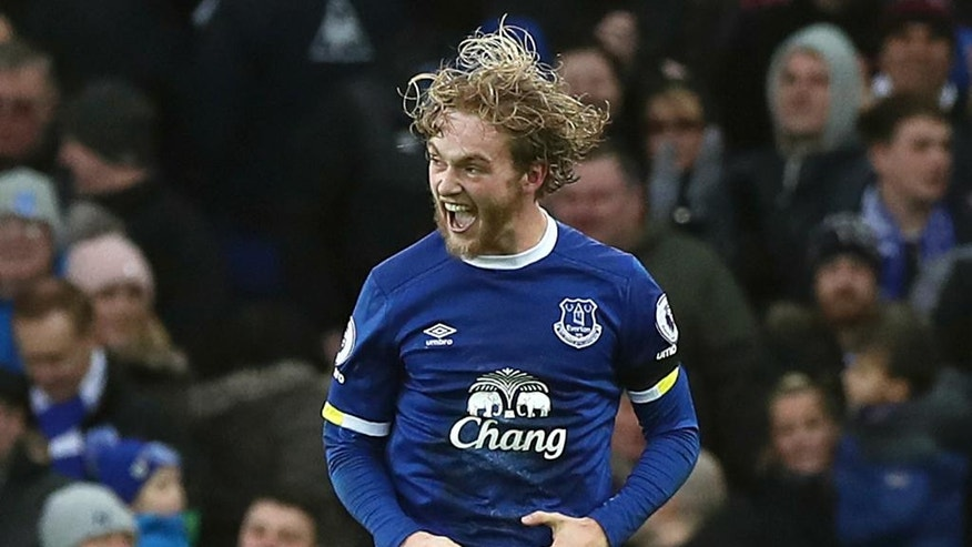 Everton's Tom Davies celebrates scoring his side's third goal, during the English Premier League soccer match between Everton and Manchester City at Goodison Park, in Liverpool, England, Sunday Jan. 15, 2017. (Peter Byrne/PA via AP)