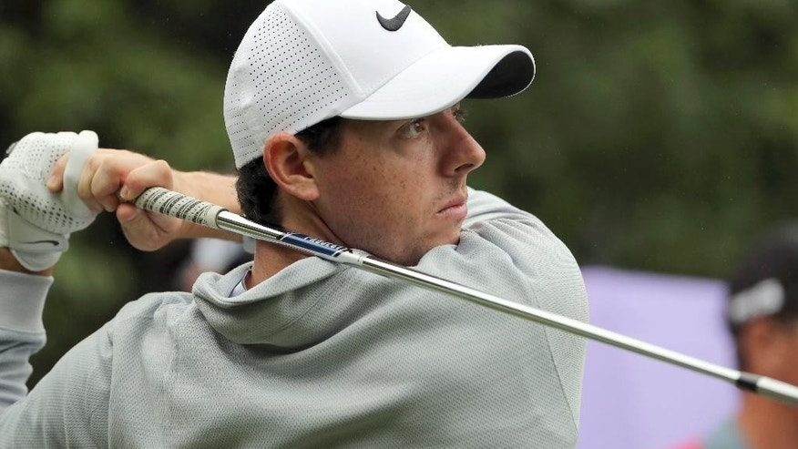 FILE - In this Thursday, Oct. 27, 2016 file photo, Rory McIlroy of Northern Ireland hits a tee shot during the WGC-HSBC Champions golf tournament at the Sheshan International Golf Club in Shanghai, China. Rory McIlroy turned in a third-round 67, to play an intriguing battle on Sunday Jan. 14, 2017. (AP Photo/Ng Han Guan, file)