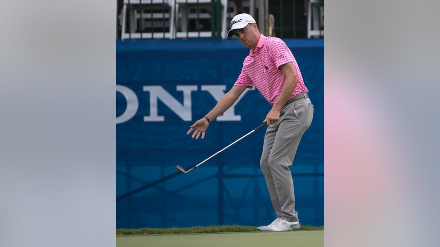 Justin Thomas reacts to his putt on the 17th green during the third round of the Sony Open golf tournament, Saturday, Jan. 14, 2017, in Honolulu. (AP Photo/Marco Garcia)