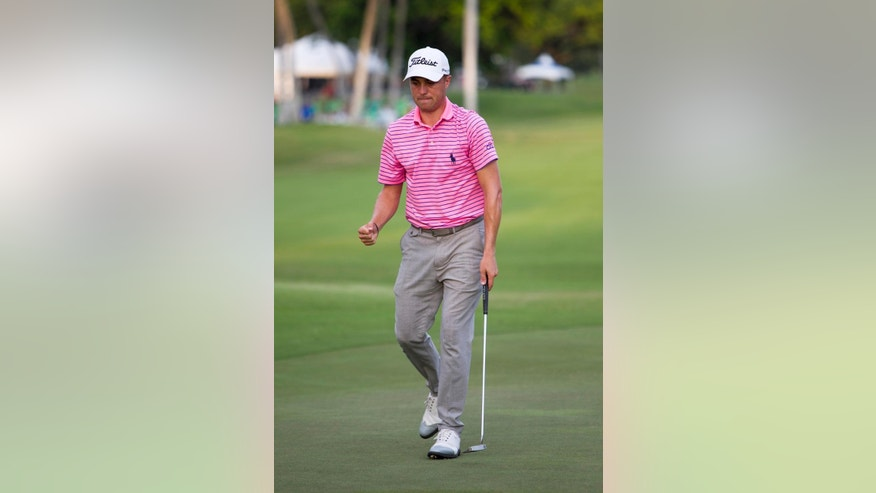 Justin Thomas reacts to his birdie putt on the 18th green during the third round of the Sony Open golf tournament, Saturday, Jan. 14, 2017, in Honolulu. (AP Photo/Marco Garcia)