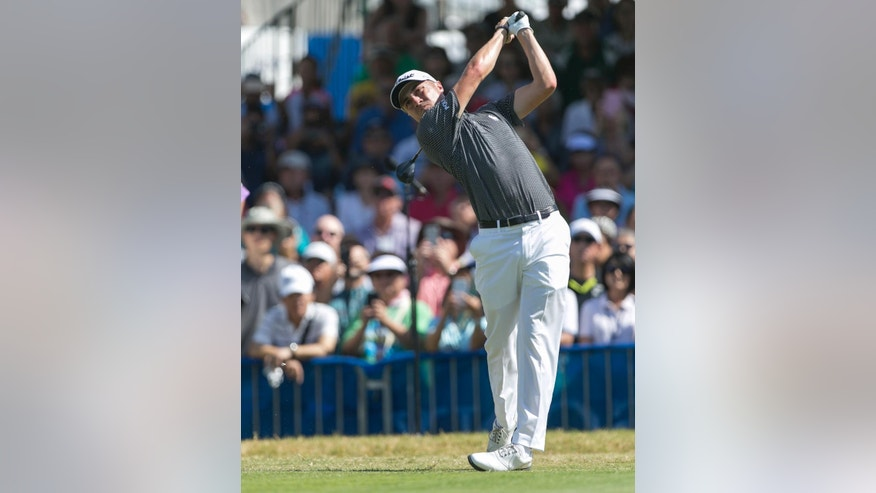Justin Thomas drives on the first tee during the final round of the Sony Open golf tournament, Sunday, Jan. 15, 2017, in Honolulu. (AP Photo/Marco Garcia)