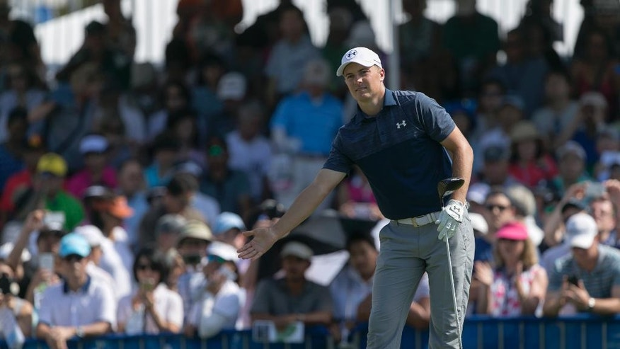 Jordan Spieth reacts to his drive off the first tee during the final round of the Sony Open golf tournament, Sunday, Jan. 15, 2017, in Honolulu. (AP Photo/Marco Garcia)