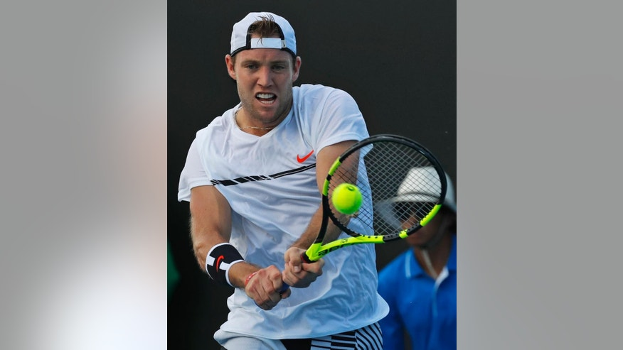 United States' Jack Sock plays a shot against France's Pierre-Hagues Herbert during their first round match at the Australian Open tennis championships in Melbourne, Australia, Monday, Jan. 16, 2017. (AP Photo/Kin Cheung)