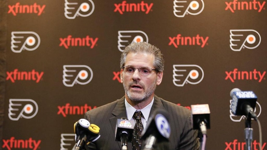 "FILE - In this April 11, 2016, file photo, Philadelphia Flyers general manager Ron Hextall speaks with members of the media during a news conference in Voorhees, N.J. Eleven losses in 14 games have made the positive vibes and good feelings from their recent 10-game winning streak feel like a distant memory. Things have gone sideways for the Flyers over the past month, and general manager Ron Hextall said ""the negative energy seems to be a landslide."" (AP Photo/Matt Rourke, File)"