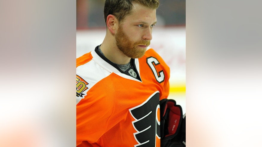 "FILE - In this Jan. 4, 2017, file photo, Philadelphia Flyers' Claude Giroux is shown before the start of an NHL hockey game, in Philadelphia. With a series of ""I don't know"" responses, captain Claude Giroux was at a loss to explain what has happened to the Philadelphia Flyers lately. Eleven losses in 14 games have made the positive vibes and good feelings from their recent 10-game winning streak feel like a distant memory. (AP Photo/Tom Mihalek, File)"