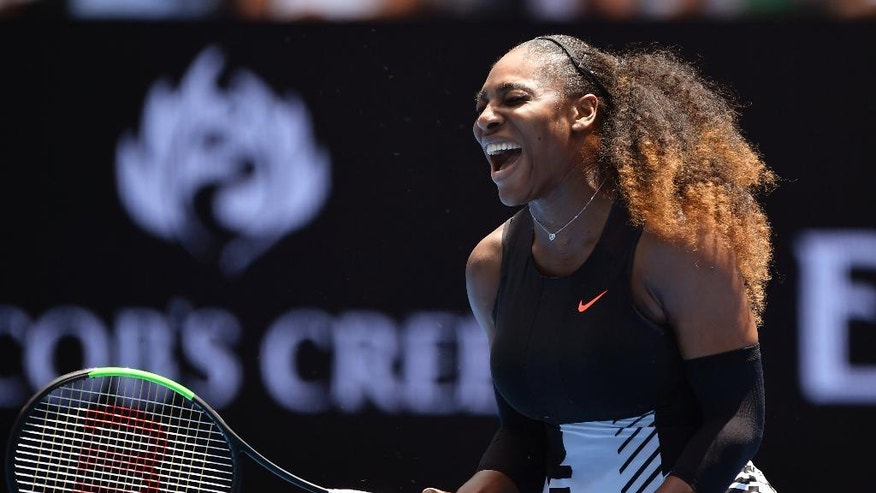 United States' Serena Williams yells out while playing Switzerland's Belinda Bencic during their first round match at the Australian Open tennis championships in Melbourne, Australia, Tuesday, Jan. 17, 2017. (AP Photo/Andy Brownbill)