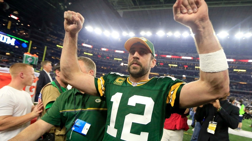 Green Bay Packers quarterback Aaron Rodgers (12) celebrates after winning an NFL divisional playoff football game against the Dallas Cowboys Sunday, Jan. 15, 2017, in Arlington, Texas.
