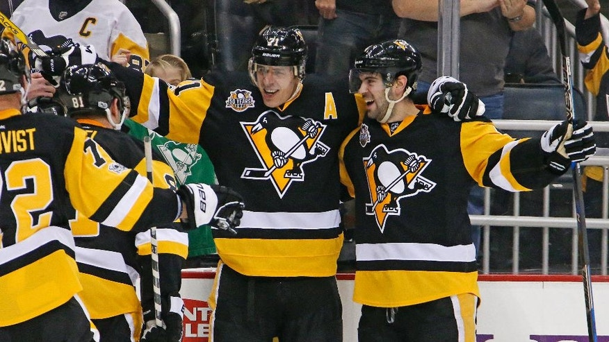 Pittsburgh Penguins' Evgeni Malkin (71) celebrates his third goal of the second period during an NHL hockey game against the Washington Capitals in Pittsburgh, Monday, Jan. 16, 2017. (AP Photo/Gene J. Puskar)