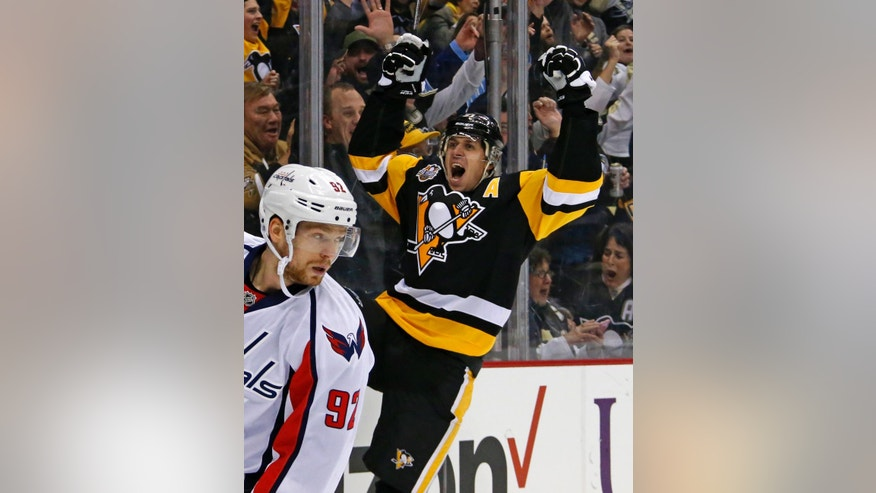 Pittsburgh Penguins' Evgeni Malkin, right, celebrates his second goal of the second period during an NHL hockey game against the Washington Capitals in Pittsburgh, Monday, Jan. 16, 2017. (AP Photo/Gene J. Puskar)