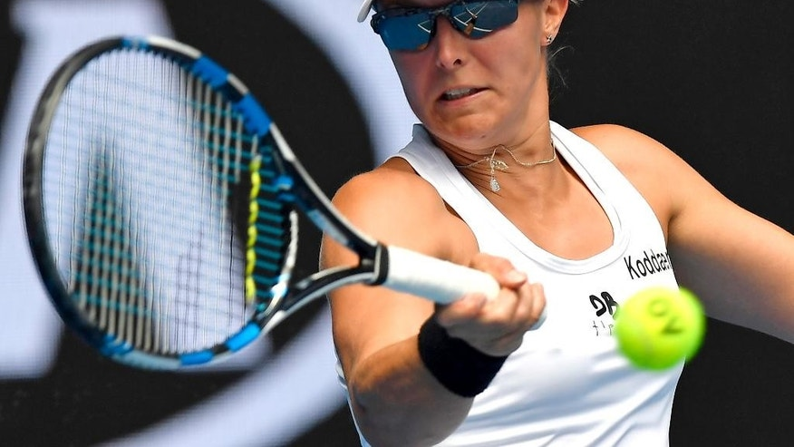 Belgium's Kirsten Flipkens makes a forehand return to Britain's Johanna Konta during their first round match at the Australian Open tennis championships in Melbourne, Australia, Tuesday, Jan. 17, 2017. (AP Photo/Andy Brownbill)
