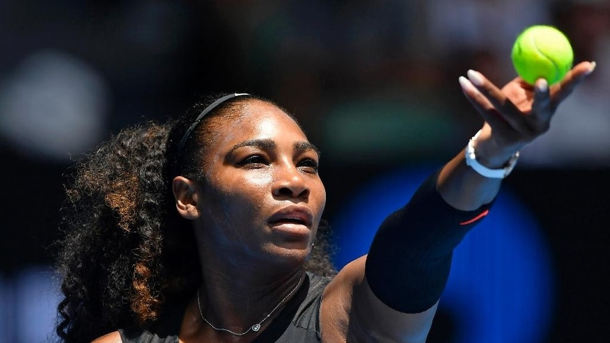 United States' Serena Williams prepares to serve to Switzerland's Belinda Bencic during their first round match at the Australian Open tennis championships in Melbourne, Australia, Tuesday, Jan. 17, 2017. (AP Photo/Andy Brownbill)