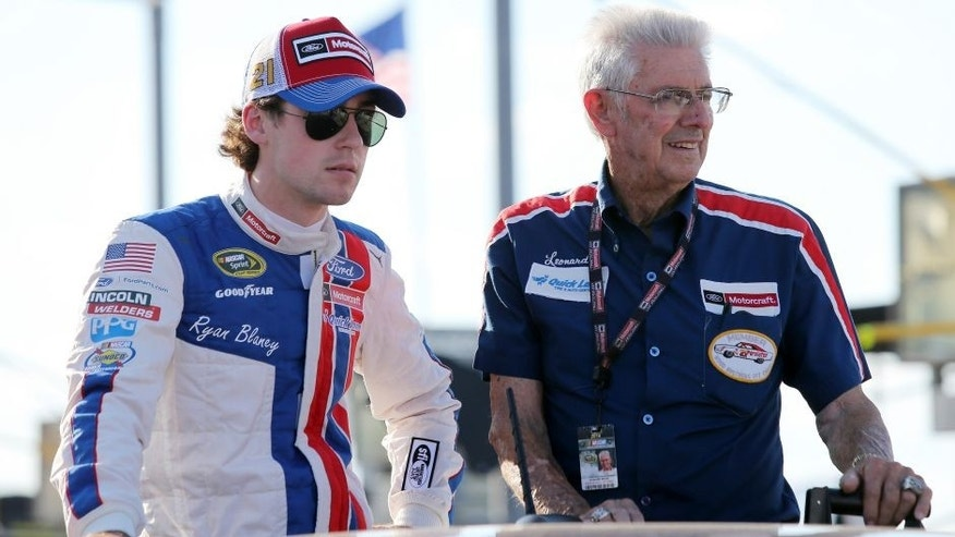 DARLINGTON, SC - SEPTEMBER 04: Ryan Blaney, driver of the #21 Motorcraft/Quick Lane Tire & Auto Center Ford, rides with NASCAR Hall of Famer Leonard Wood during pre-race festivities for the NASCAR Sprint Cup Series Bojangles' Southern 500 at Darlington Raceway on September 4, 2016 in Darlington, South Carolina. (Photo by Jerry Markland/Getty Images)