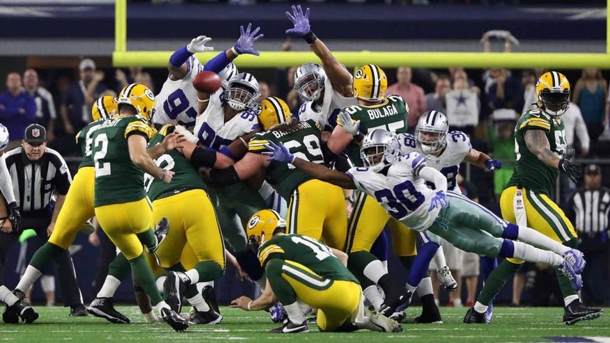 Jan 15, 2017; Arlington, TX, USA; Green Bay Packers kicker Mason Crosby (2) kicks the game winning field goal during the fourth quarter against the Dallas Cowboys in the NFC Divisional playoff game at AT&T Stadium. Mandatory Credit: Kevin Jairaj-USA TODAY Sports