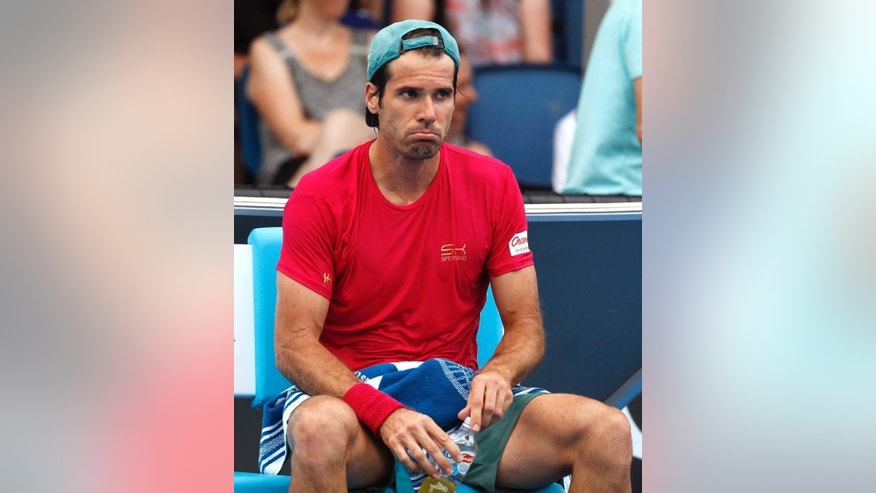 Germany's Tommy Haas rests as Haas plays France's Benoit Paire during their first round match at the Australian Open tennis championships in Melbourne, Australia, Tuesday, Jan. 17, 2017. (AP Photo/Kin Cheung)