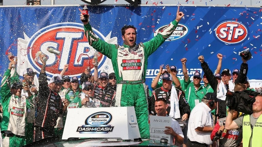 JOLIET, IL - JULY 22: Elliott Sadler, driver of the #2 Hunt Brothers Pizza Chevrolet, celebrates winning the NASCAR Nationwide Series STP 300 at Chicagoland Speedway on July 22, 2012 in Joliet, Illinois. (Photo by Jonathan Daniel/Getty Images)