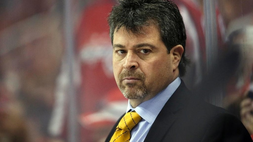 FILE - In this April 5, 2016, file photo, New York Islanders head coach Jack Capuano stands in the bench during the second period of an NHL hockey game against the Washington Capitals in Washington. The struggling islanders fired Capuano on Tuesday, Jan. 17, 2017, ending his tenure in the middle of its seventh season. (AP Photo/Alex Brandon, File)